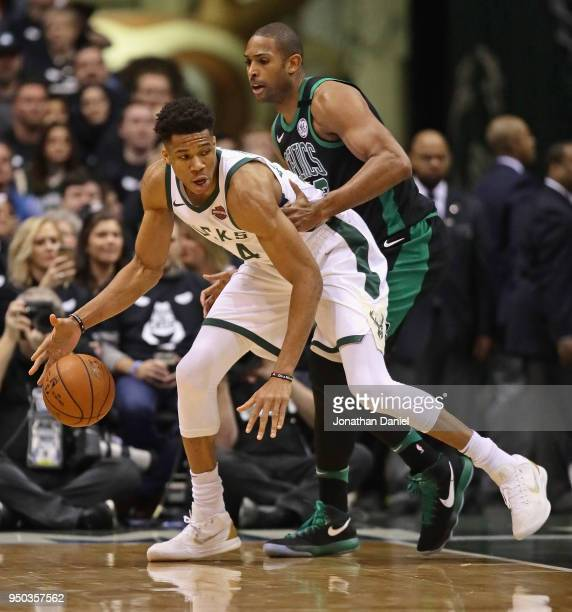 Giannis Antetokounmpo of the Milwaukee Bucks moves against Al Horford of the Boston Celtics during Game Four of Round One of the 2018 NBA Playoffs at...