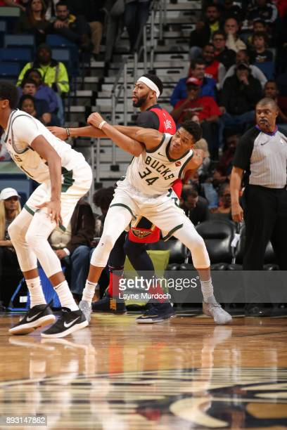 Giannis Antetokounmpo of the Milwaukee Bucks on the defense against Anthony Davis of the New Orleans Pelicans on December 13 2017 at Smoothie King...