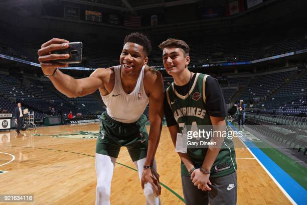 Giannis Antetokounmpo of the Milwaukee Bucks participates in a Make a Wish event before the game on February 13 2018 at the Bradley Center in...