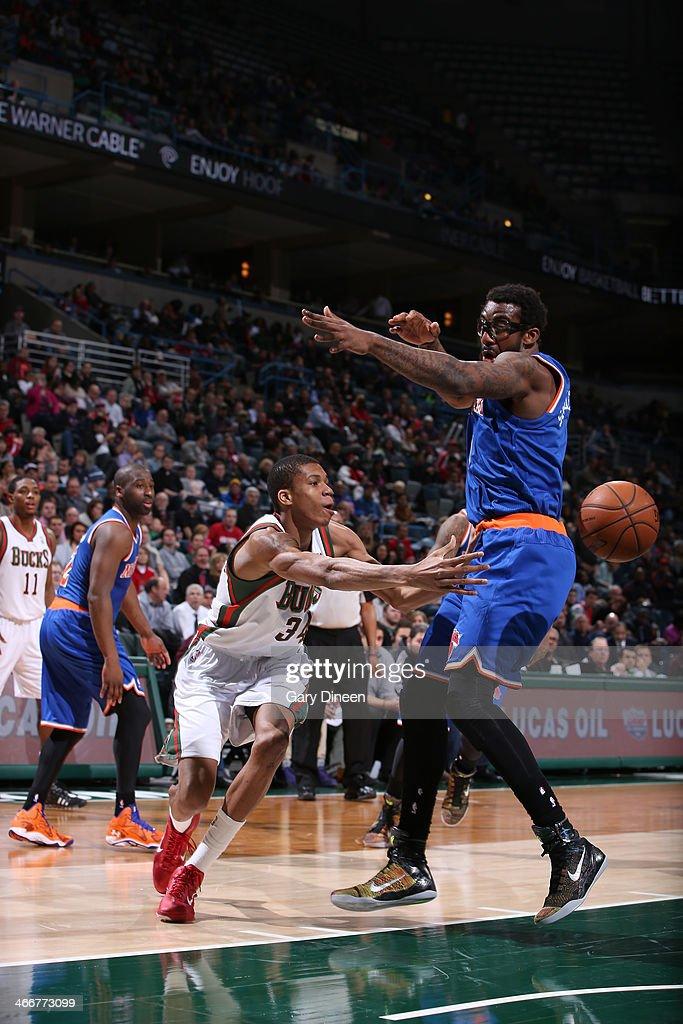 Giannis Antetokounmpo #34 of the Milwaukee Bucks passes against Amar'e Stoudemire #1 of the New York Knicks on February 3, 2014 at the BMO Harris Bradley Center in Milwaukee, Wisconsin.