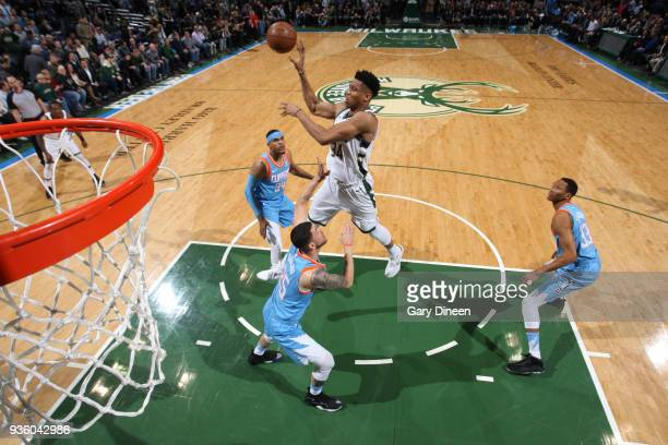 Giannis Antetokounmpo of the Milwaukee Bucks passes against Tobias Harris Austin Rivers and Wesley Johnson of the Los Angeles Clippers during the NBA...
