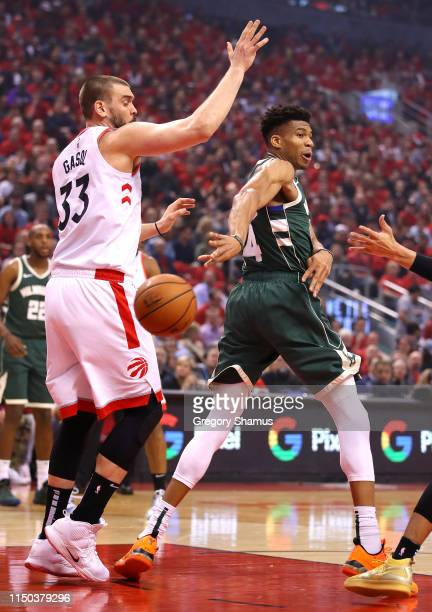 Giannis Antetokounmpo of the Milwaukee Bucks passes the ball against Marc Gasol of the Toronto Raptors during the first half in game three of the NBA...