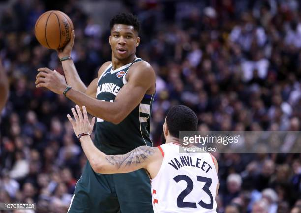 Giannis Antetokounmpo of the Milwaukee Bucks passes the ball as Fred VanVleet of the Toronto Raptors defends during the second half of an NBA game at...