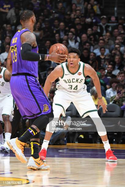 Giannis Antetokounmpo of the Milwaukee Bucks plays defense against LeBron James of the Los Angeles Lakers on March 1 2019 at STAPLES Center in Los...