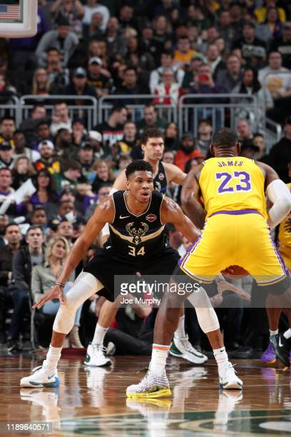 Giannis Antetokounmpo of the Milwaukee Bucks plays defense against LeBron James of the Los Angeles Lakers on December 19 2019 at the Fiserv Forum...