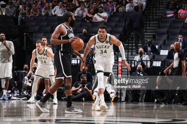 Giannis Antetokounmpo of the Milwaukee Bucks plays defense as James Harden of the Brooklyn Nets handles the ball during the game during Round 2, Game...