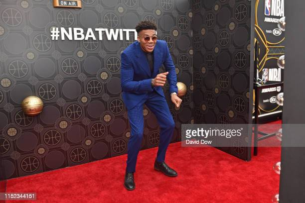 Giannis Antetokounmpo of the Milwaukee Bucks poses for a photo on the red carpet before the 2019 NBA Awards Show on June 24 2019 at Barker Hangar in...
