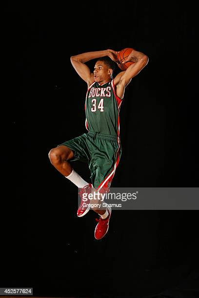 Giannis Antetokounmpo of the Milwaukee Bucks poses for a portrait during the 2013 NBA rookie photo shoot on August 6 2013 at the Madison Square...