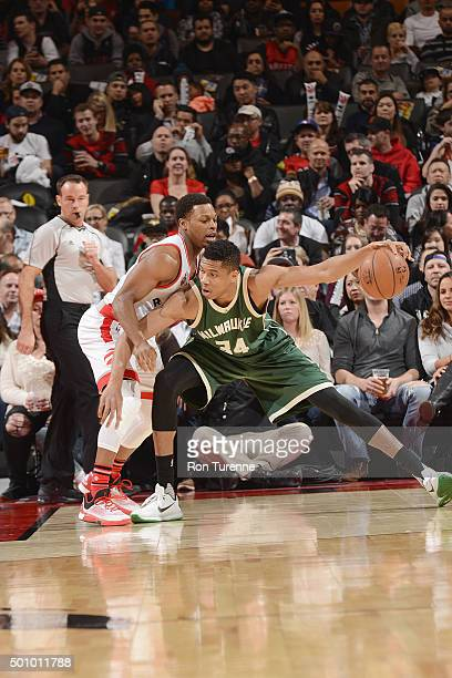 Giannis Antetokounmpo of the Milwaukee Bucks posts up against Kyle Lowry of the Toronto Raptors on December 11 2015 at the Air Canada Centre in...
