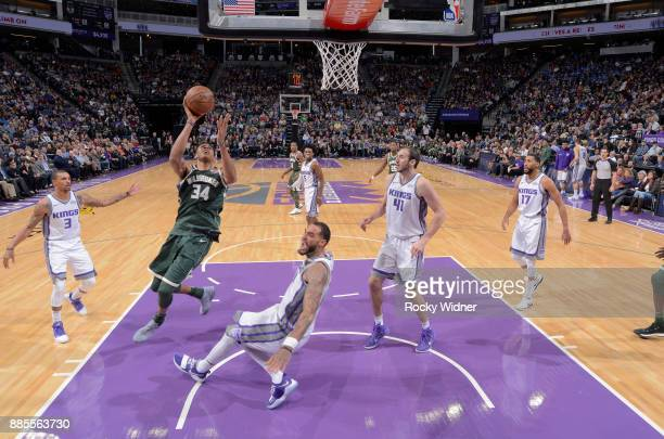Giannis Antetokounmpo of the Milwaukee Bucks puts up a shot against Willie CauleyStein of the Sacramento Kings on November 28 2017 at Golden 1 Center...