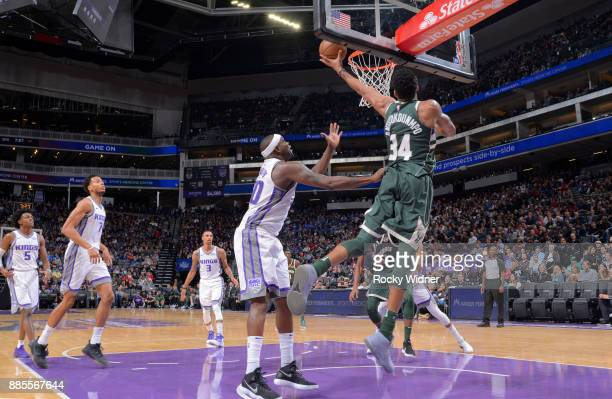 Giannis Antetokounmpo of the Milwaukee Bucks puts up a shot against Zach Randolph of the Sacramento Kings on November 28 2017 at Golden 1 Center in...