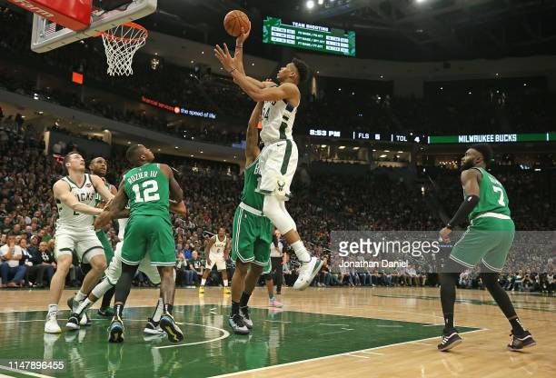 Giannis Antetokounmpo of the Milwaukee Bucks puts up a shot over Terry Rozier of the Boston Celtics at Fiserv Forum on May 08 2019 in Milwaukee...