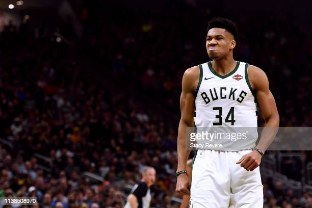 Giannis Antetokounmpo of the Milwaukee Bucks reacts after a dunk against the Houston Rockets during the first half of a game at Fiserv Forum on March...