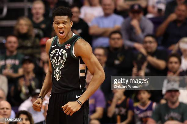 Giannis Antetokounmpo of the Milwaukee Bucks reacts after a slam dunk against the Phoenix Suns during the first half of the NBA game at Talking Stick...