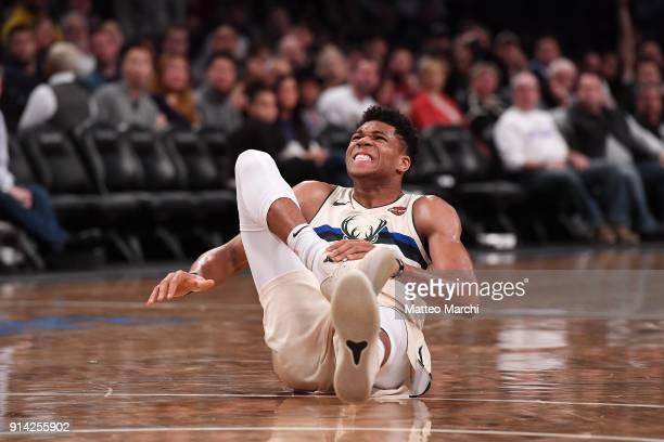 Giannis Antetokounmpo of the Milwaukee Bucks reacts after injuring his right ankle during the game against the Brooklyn Nets at Barclays Center on...