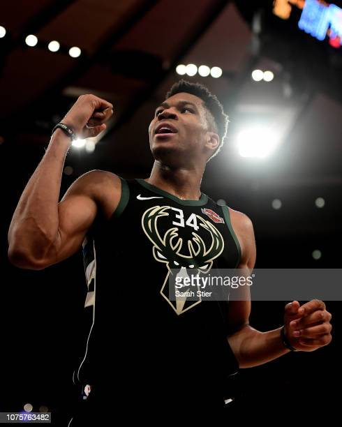 Giannis Antetokounmpo of the Milwaukee Bucks reacts during the fourth quarter of the game against New York Knicks at Madison Square Garden on...