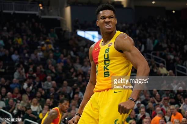 Giannis Antetokounmpo of the Milwaukee Bucks reacts to a dunk against the Denver Nuggets during a game at Fiserv Forum on November 19 2018 in...