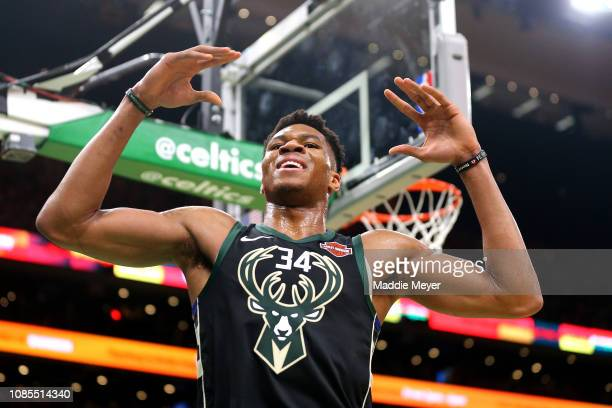 Giannis Antetokounmpo of the Milwaukee Bucks reacts to a foul called against him during the game against the Boston Celtics at TD Garden on December...