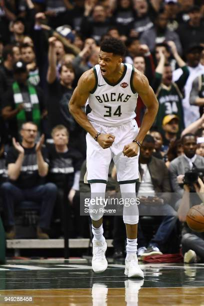 Giannis Antetokounmpo of the Milwaukee Bucks reacts to a score against the Boston Celtics during the first half of game three of round one of the...