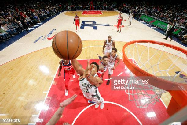 Giannis Antetokounmpo of the Milwaukee Bucks rebounds the ball during the game against the Washington Wizards on January 15 2018 at Capital One Arena...