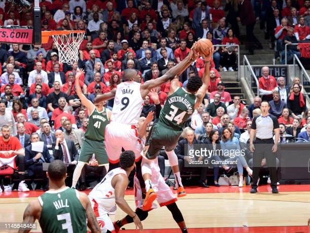 Giannis Antetokounmpo of the Milwaukee Bucks rebounds the ball against the Toronto Raptors during Game Four of the Eastern Conference Finals of the...
