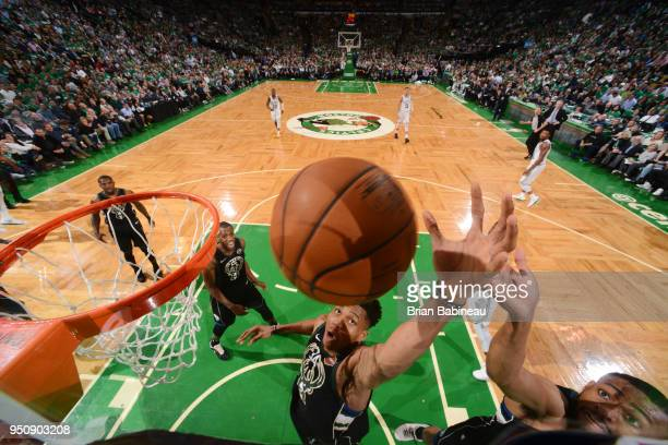 Giannis Antetokounmpo of the Milwaukee Bucks rebounds the ball against the Boston Celtics Game Five of Round One of the 2018 NBA Playoffs on April 24...