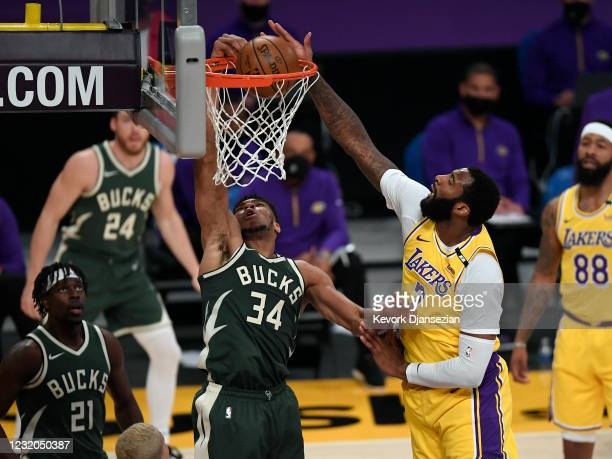 Giannis Antetokounmpo of the Milwaukee Bucks scores a basket against Andre Drummond of the Los Angeles Lakers during the first half of the game at...