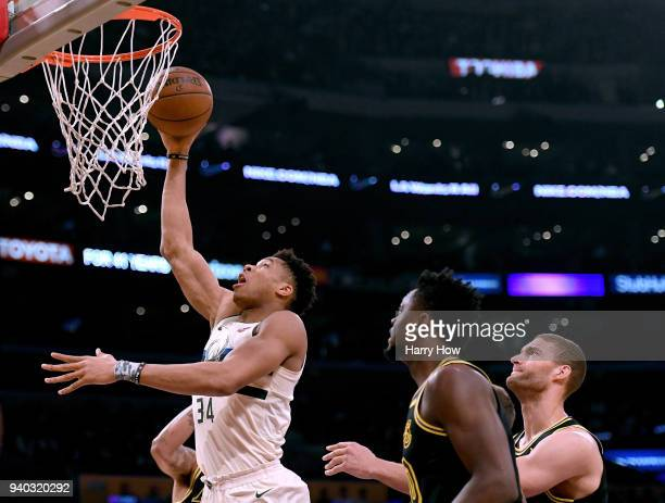 Giannis Antetokounmpo of the Milwaukee Bucks scores in front of Julius Randle and Brook Lopez of the Los Angeles Lakers during the first half at...