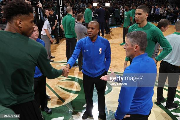 Giannis Antetokounmpo of the Milwaukee Bucks shakes hands with referee Sean Corbin before the game against the Boston Celtics in Game Three of Round...