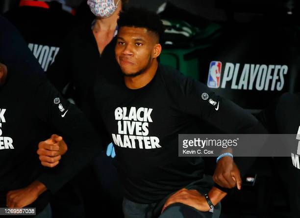 Giannis Antetokounmpo of the Milwaukee Bucks sheds a tear before the start of a game against the Orlando Magic in Game Five of the Eastern Conference...