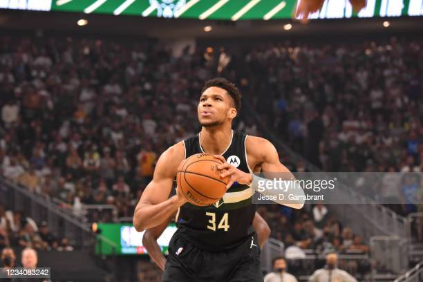 Giannis Antetokounmpo of the Milwaukee Bucks shoots a free throw during Game Six of the 2021 NBA Finals on July 20, 2021 at Fiserv Forum in...