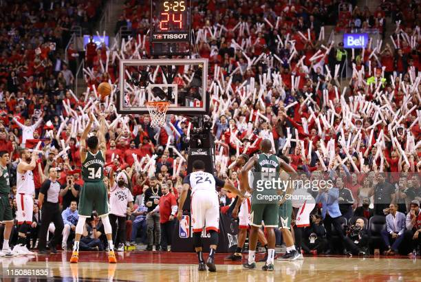 Giannis Antetokounmpo of the Milwaukee Bucks shoots a free throw during the second half against the Toronto Raptors in game four of the NBA Eastern...
