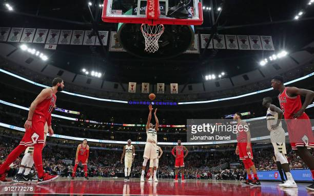 Giannis Antetokounmpo of the Milwaukee Bucks shoots a free throw against the Chicago Bulls at the United Center on January 28 2018 in Chicago...