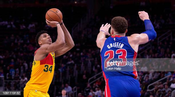 Giannis Antetokounmpo of the Milwaukee Bucks shoots a three point shot as Blake Griffin of the Detroit Pistons defends during the fourth quarter of...