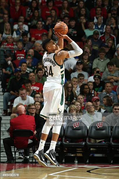 Giannis Antetokounmpo of the Milwaukee Bucks shoots against the Minnesota Timberwolves on October 20 2015 at the Kohl Center in Madison Wisconsin...