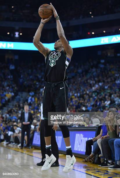 Giannis Antetokounmpo of the Milwaukee Bucks shoots against the Golden State Warriors during an NBA basketball game at ORACLE Arena on March 29 2018...