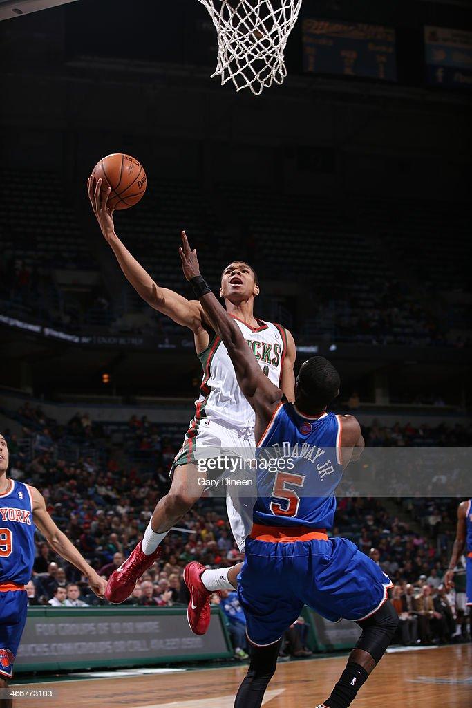 Giannis Antetokounmpo #34 of the Milwaukee Bucks shoots against Tim Hardaway Jr.#5 of the New York Knicks on February 3, 2014 at the BMO Harris Bradley Center in Milwaukee, Wisconsin.