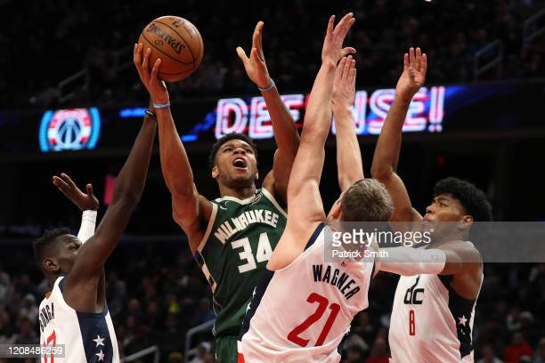 Giannis Antetokounmpo of the Milwaukee Bucks shoots in front of Moritz Wagner, Isaac Bonga, and Rui Hachimura of the Washington Wizards during the...