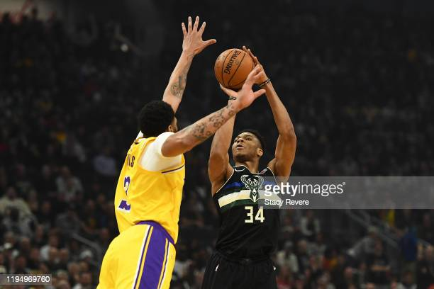 Giannis Antetokounmpo of the Milwaukee Bucks shoots over Anthony Davis of the Los Angeles Lakers during the first half of a game at Fiserv Forum on...