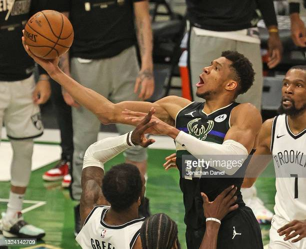 Giannis Antetokounmpo of the Milwaukee Bucks shoots over Jeff Green of the Brooklyn Nets at Fiserv Forum on June 17, 2021 in Milwaukee, Wisconsin....