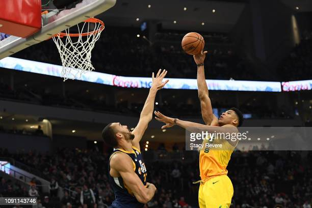 Giannis Antetokounmpo of the Milwaukee Bucks shoots over Rudy Gobert of the Utah Jazz during the second half of a game at Fiserv Forum on January 07...