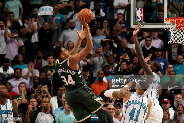 Giannis Antetokounmpo of the Milwaukee Bucks shoots the ball against the Charlotte Hornets during a game on October 17 2018 at Spectrum Center in...