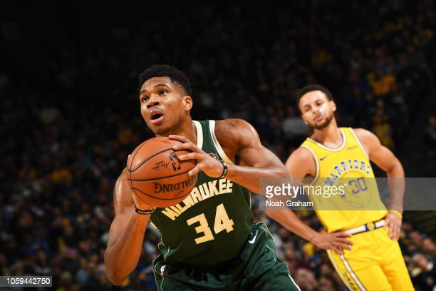 Giannis Antetokounmpo of the Milwaukee Bucks shoots the ball against the Golden State Warriors on November 8 2018 at ORACLE Arena in Oakland...