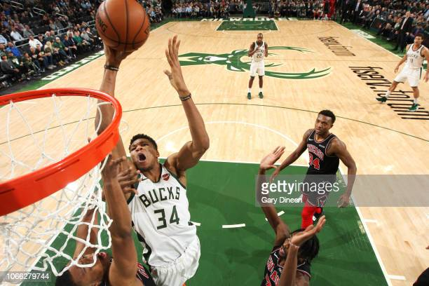Giannis Antetokounmpo of the Milwaukee Bucks shoots the ball against the Chicago Bulls on November 28 2018 at the United Center in Chicago Illinois...
