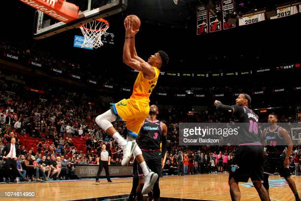 Giannis Antetokounmpo of the Milwaukee Bucks shoots the ball against the Miami Heat on December 22 2018 at American Airlines Arena in Miami Florida...