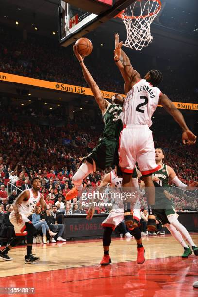Giannis Antetokounmpo of the Milwaukee Bucks shoots the ball against the Toronto Raptors during Game Four of the Eastern Conference Finals on May 21...