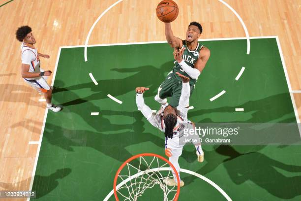 Giannis Antetokounmpo of the Milwaukee Bucks shoots the ball against the Phoenix Suns during Game Three of the 2021 NBA Finals on July 11, 2021 at...