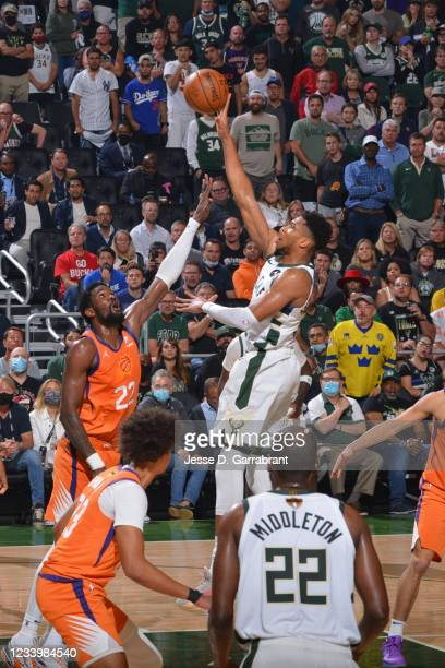 Giannis Antetokounmpo of the Milwaukee Bucks shoots the ball against the Phoenix Suns during Game Four of the 2021 NBA Finals on July 14, 2021 at...