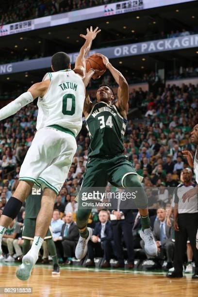 Giannis Antetokounmpo of the Milwaukee Bucks shoots the ball against the Boston Celtics on October 18 2017 at the TD Garden in Boston Massachusetts...