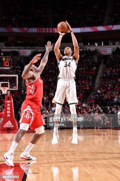 Giannis Antetokounmpo of the Milwaukee Bucks shoots the ball against the Houston Rockets on December 16 2017 at the Toyota Center in Houston Texas...